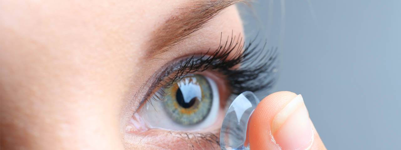 Woman putting in Contact Lenses in Flagstaff